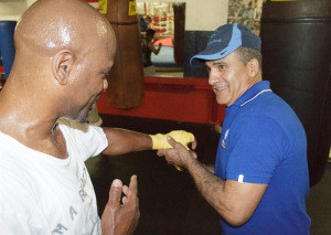 Jorge Gallardo, long-time trainer of former world champion Willy Wise, wrapping his hand more than a decade after their last fight together as a team in preparation for a sparring session.